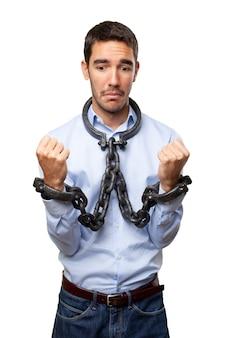 鎖の手でストレスを与えられたビジネスマン