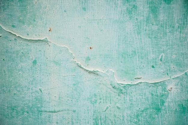 Старая сине-зеленая стена с ржавчиной