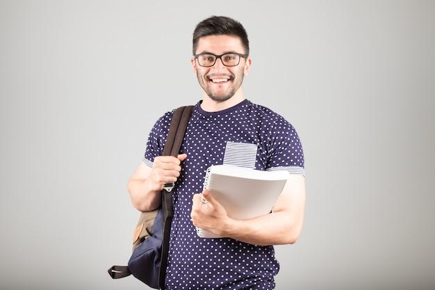 Студент с рюкзаком и книгой