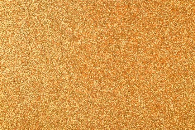 焦点を当てた黄金の抽象的なキラキラ背景