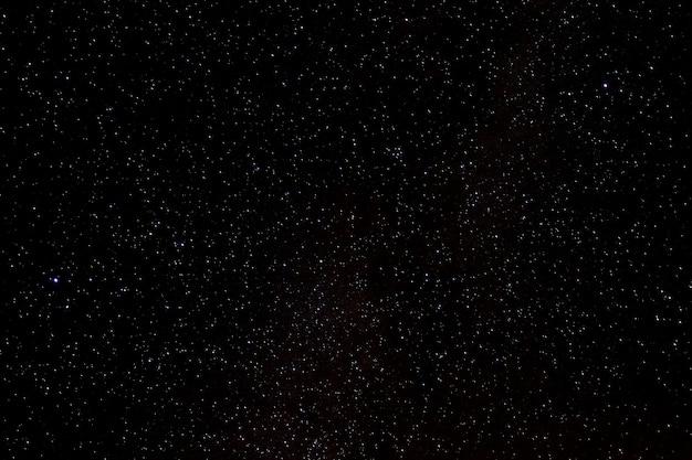 光沢のあるスターフィールドの星と銀河の宇宙空の夜宇宙黒星空の背景