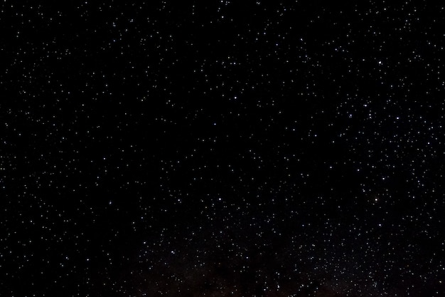 星と銀河宇宙の空の夜の宇宙黒い光沢のあるスターフィールドの星空の背景