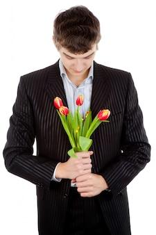 Бизнесмен предлагая тюльпан