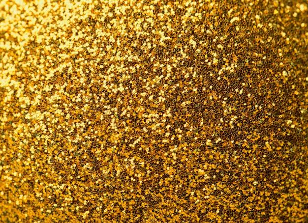 抽象的なクリスマスゴールデン光沢のある背景