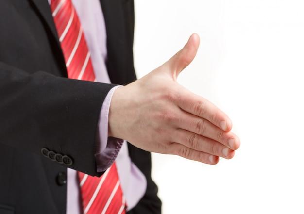 白の握手を提供しているビジネスの男性