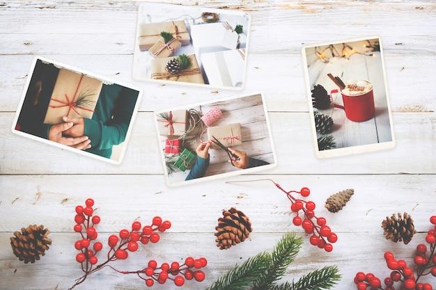 木のテーブルのクリスマス(冬季)の思い出とノスタルジアのフォトアルバム。レトロなカメラの写真 - ヴィンテージとレトロスタイル、トップビュー