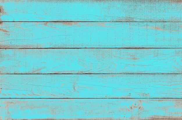 Старые выветривания деревянные доски окрашены в бирюзовый цвет.