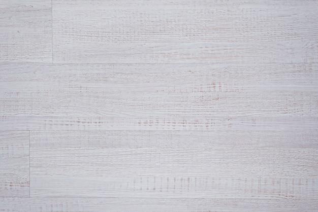 ウッドテクスチャ、白い木製の背景、灰色の板ストライプ木材デスクをクローズアップ