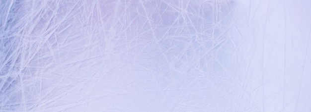 グレーとライトブルーの滑らかなブラシをかけられた金属の背景の抽象的なテクスチャ