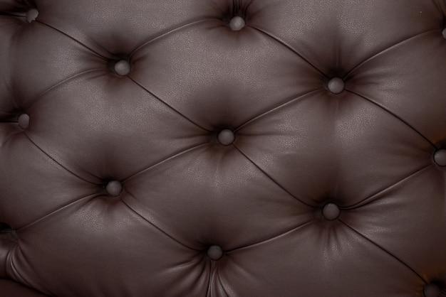 Роскошный синий кожаный диван фоновой текстуры крупным планом