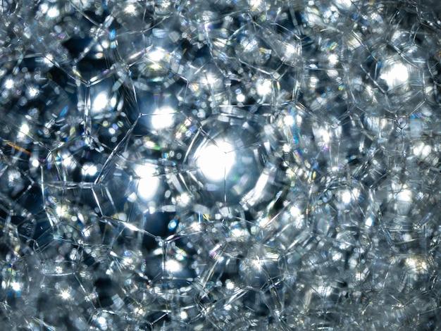 水の上の多くの泡青いテクスチャシャボン玉