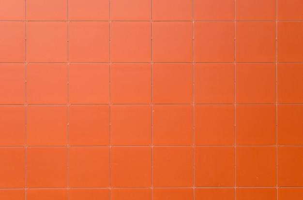 Фон оранжевый плитки текстуры фона
