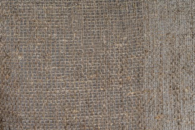 リネン生地の質感。荒い糸。黄麻布の背景。