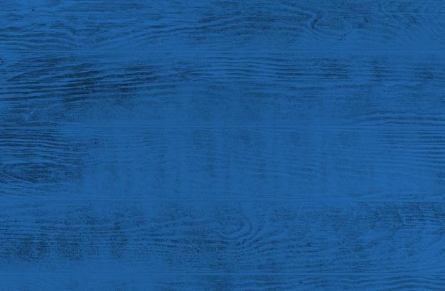 古典的な青い色の素朴な木製の背景