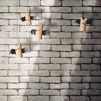 レンガの壁にハロウィーンの甘いコウモリ。ハロウィーンの概念の背景。