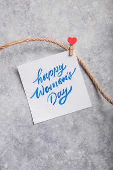 Карточка с днем счастливых женщин на сером столе