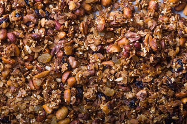 テクスチャオートミールグラノーラまたはミューズリー。食品のコンセプト。健康で健康的な食べ物。