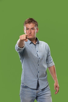 圧倒的なビジネスマンを指すし、あなたは、緑の半分の長さのクローズアップの肖像画が欲しい