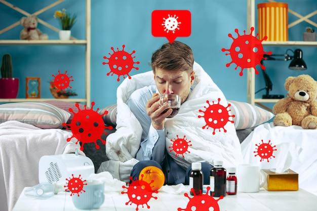 若い男はコロナウイルスの蔓延と世界的な事件を怖がっています