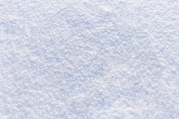 新鮮な明るい雪のテクスチャの背景