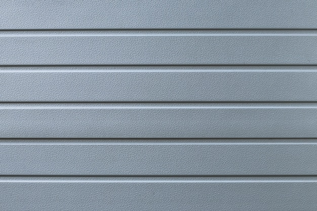 灰色のリブ付き金属フェンスのテクスチャ。