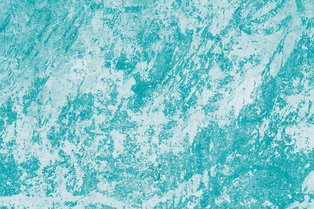 霜降り効果を持つ抽象的なターコイズパターン。緑のペンキ壁の背景。
