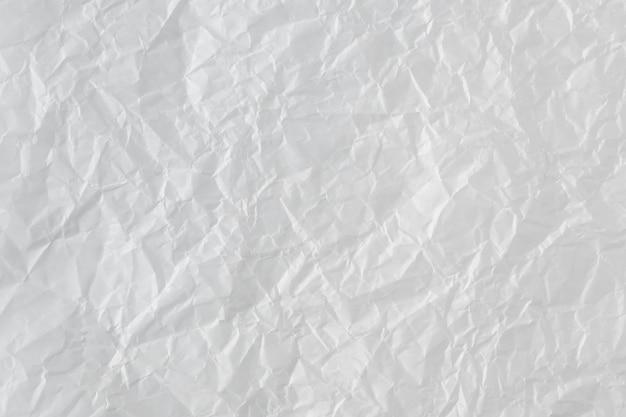 しわくちゃの紙の背景。抽象的なテクスチャ、しわのある表面。