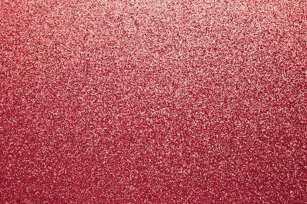 光沢のある赤い布。きらめくスパンコールのテクスチャ。抽象的な輝きの布、パターン。華麗な繊維の背景。