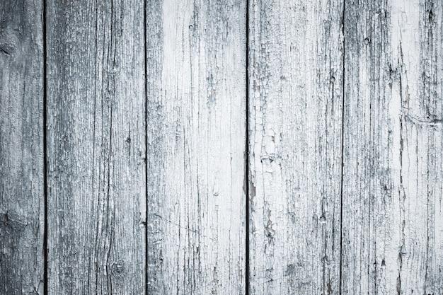 フレーク状の木製のフェンスの背景。古い木材のテクスチャ。塗装された木材の床、素朴な自然なグランジボード、デスクの表面。
