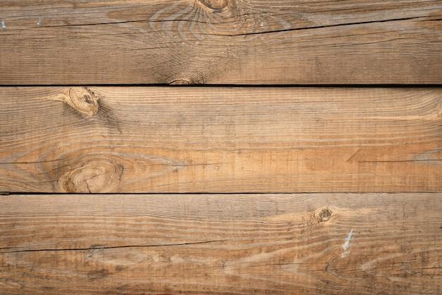 木製パネル、オーク材のテーブルの質感。板張りの床、木製の机。茶色のスラット、壁の背景。木材表面、ログパターン。