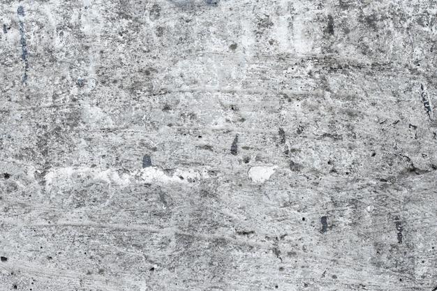 レトロな灰色のコンクリートの壁のテクスチャ。灰色のグランジ背景、床。汚れた石の表面、みすぼらしいセメントフレーム。