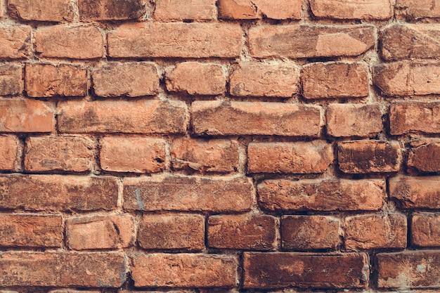 ヴィンテージの古い赤レンガの壁の背景、コンクリートグランジテクスチャの抽象的なパターン。