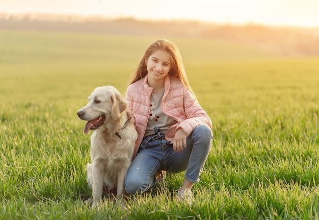 Счастливая девушка с милой собакой