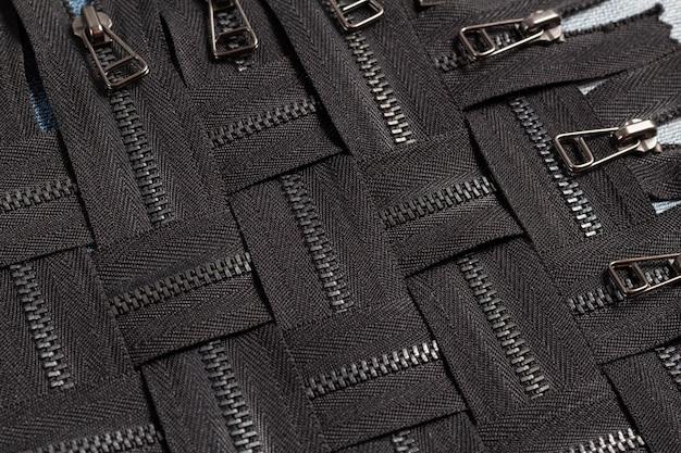 スライダーパターンで多くの黒い金属真鍮ジッパーストライプを詰める