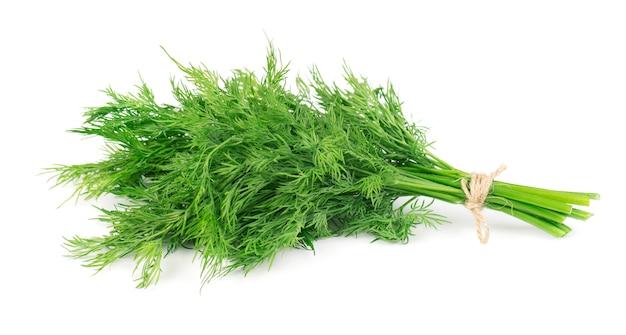 白で隔離される新鮮な緑のディルの束