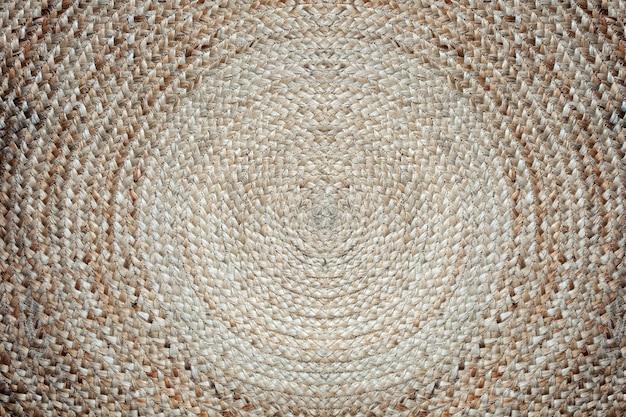 Узор из плетеной циновки, круглая плетеная циновка, круг коричневого цвета, фоновая текстура