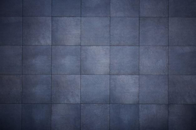 暗い灰色のタイルから抽象的な背景