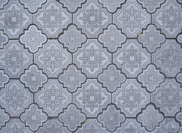 灰色の装飾的な通りのタイルの背景。