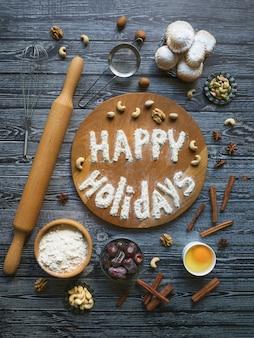 幸せな休日の食べ物の背景。卵、小麦粉、ナッツは木製のテーブルの上に並べられます。
