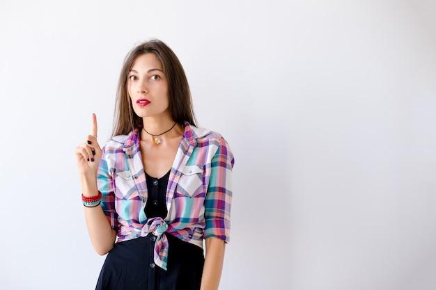 肖像若い女性の女の子の人差し指
