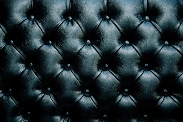 Черная кожа текстура фон с застегнутым узором