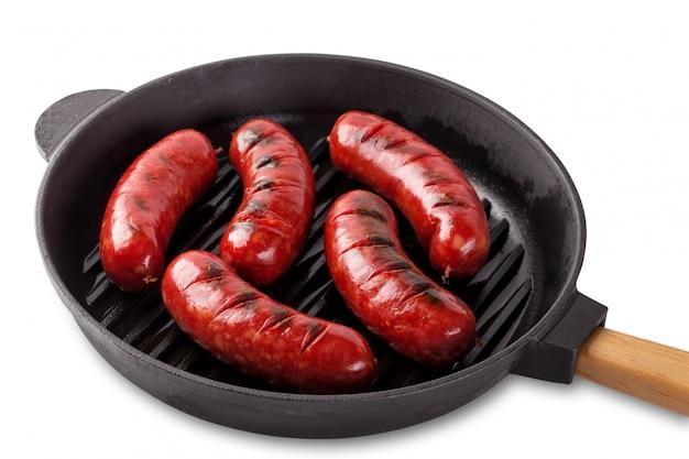 ハンドル付き鋳鉄製フライパンで揚げた芳香肉ソーセージ