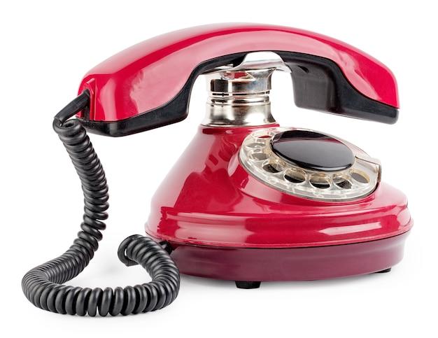 Красный старый телефон с диском