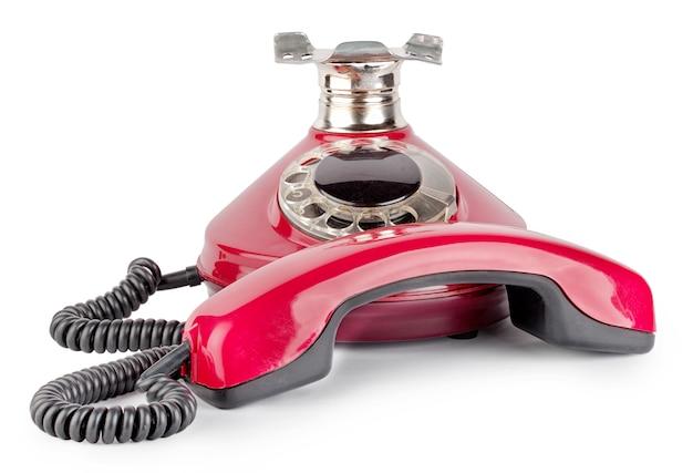 Красный старый телефон с крючка