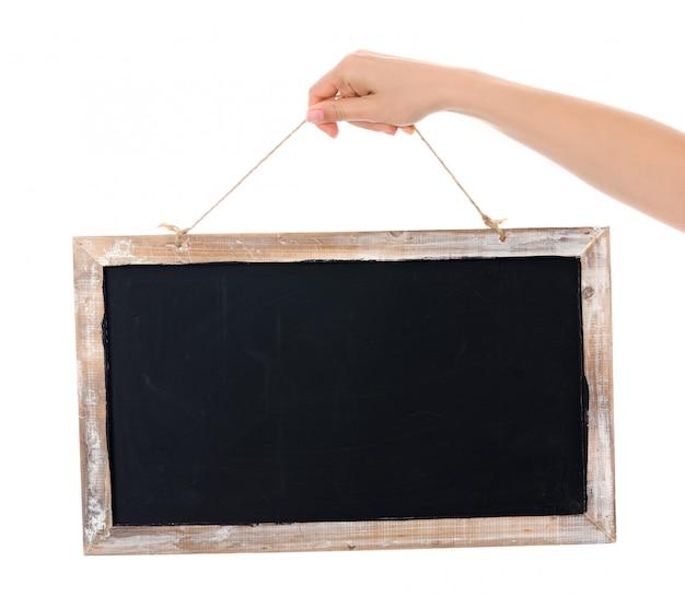 黒板のクローズアップと手