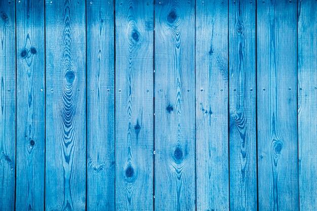 ダークブルーの木製ボード、美しいテクスチャ背景で水平に配置