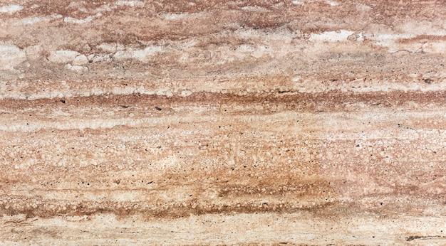 天然石、黄色のトラバーチン、または大理石の背景の高品質のテクスチャ