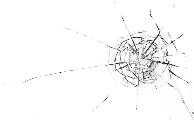 黒い背景にガラスに丸いひび。弾丸のガラス表面の穴。