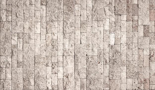 Текстура каменной стены, квадратная желтая плитка травертина. элемент дизайна или фон.