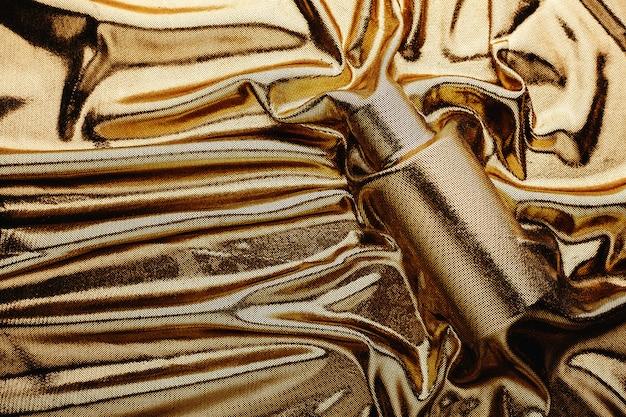 Флакон духов и золотая ткань